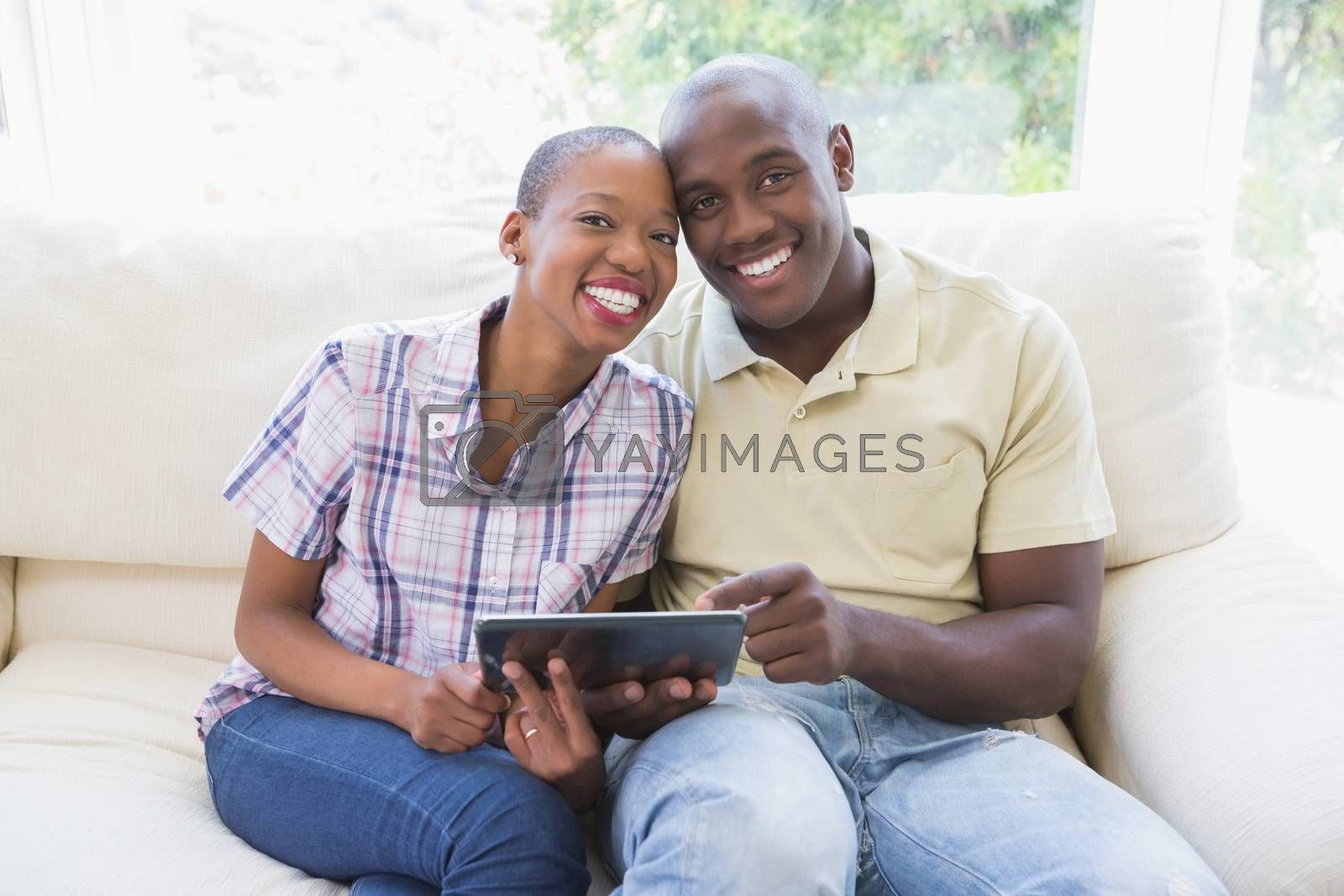 Royalty free image of portrait of a happy smiling couple using digital tablet by Wavebreakmedia