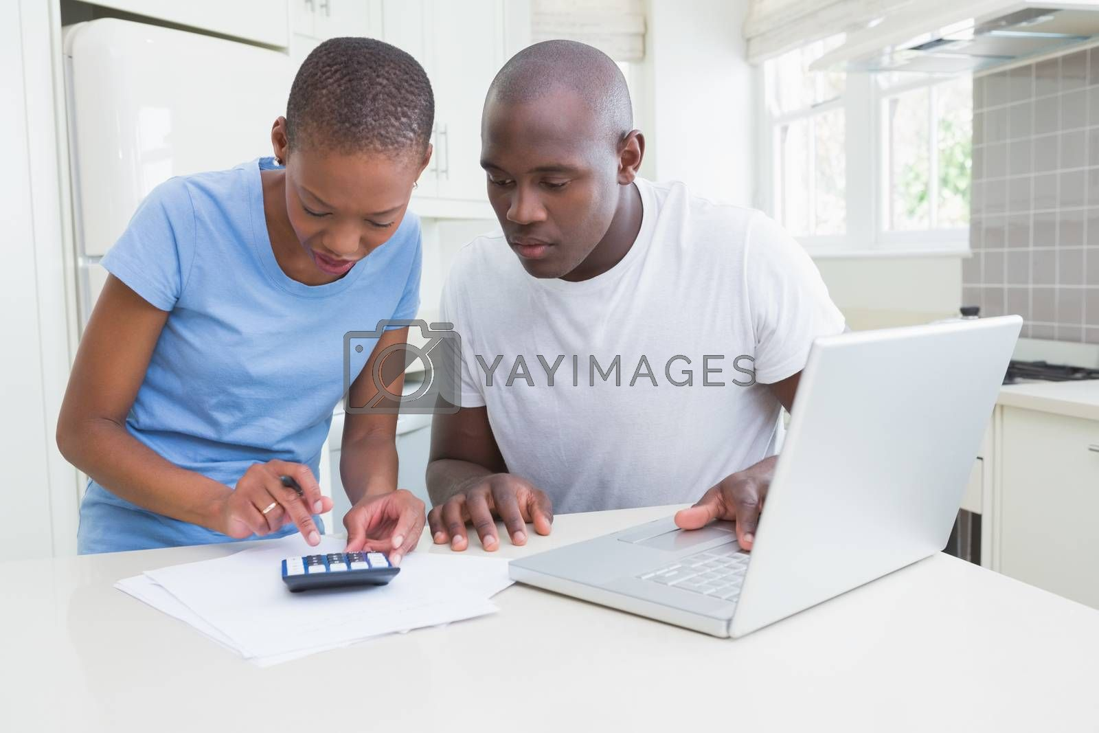 Royalty free image of Happy couple working and using laptop  by Wavebreakmedia