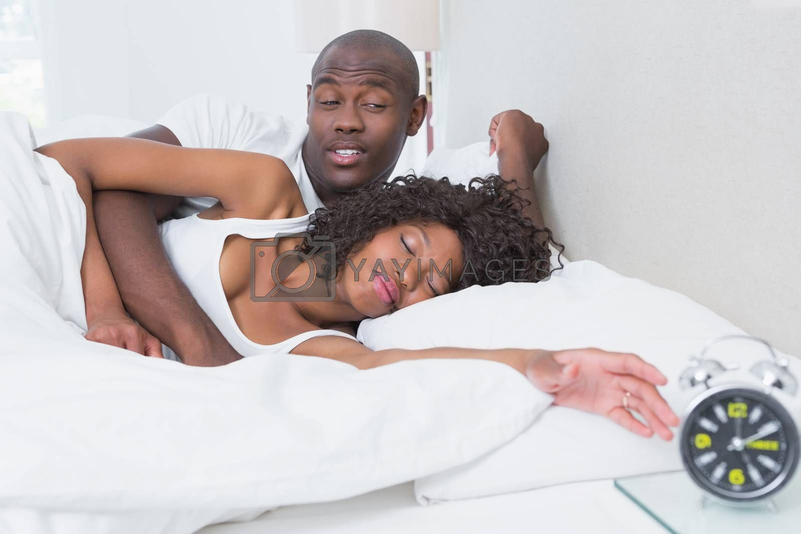 Royalty free image of Happy smiling couple in bed by Wavebreakmedia
