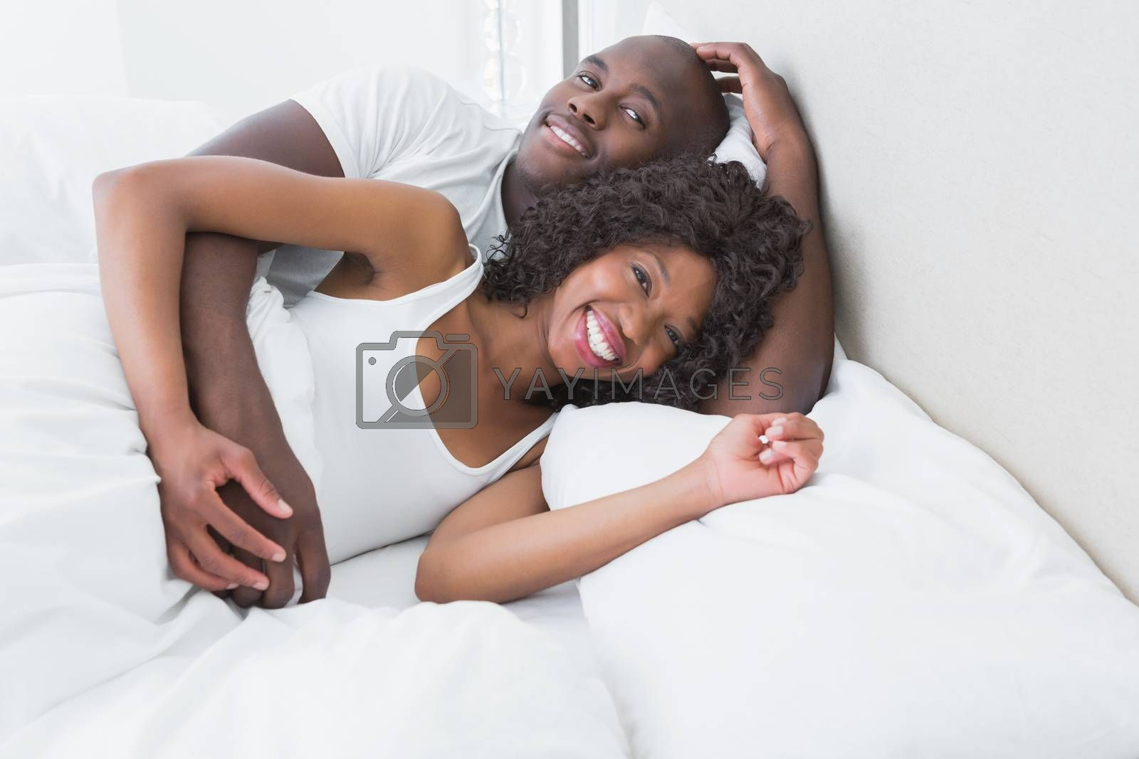 Royalty free image of A very cute couple in bed together  by Wavebreakmedia