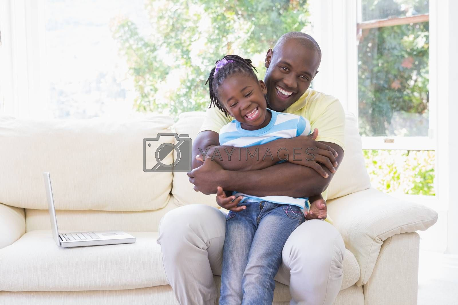 Royalty free image of Happy smiling father to hug with her daughter in couch by Wavebreakmedia