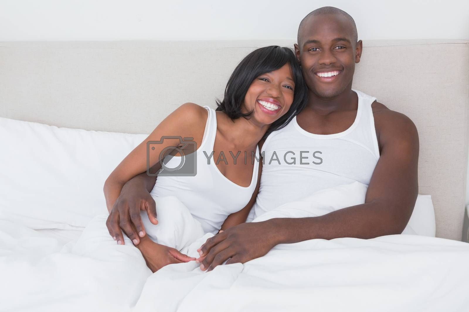 Royalty free image of Portrait of a pretty couple in their bed  by Wavebreakmedia