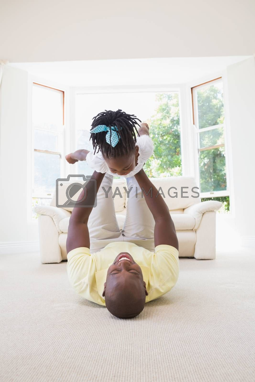 Royalty free image of Happy smiling father holding her daughter  by Wavebreakmedia