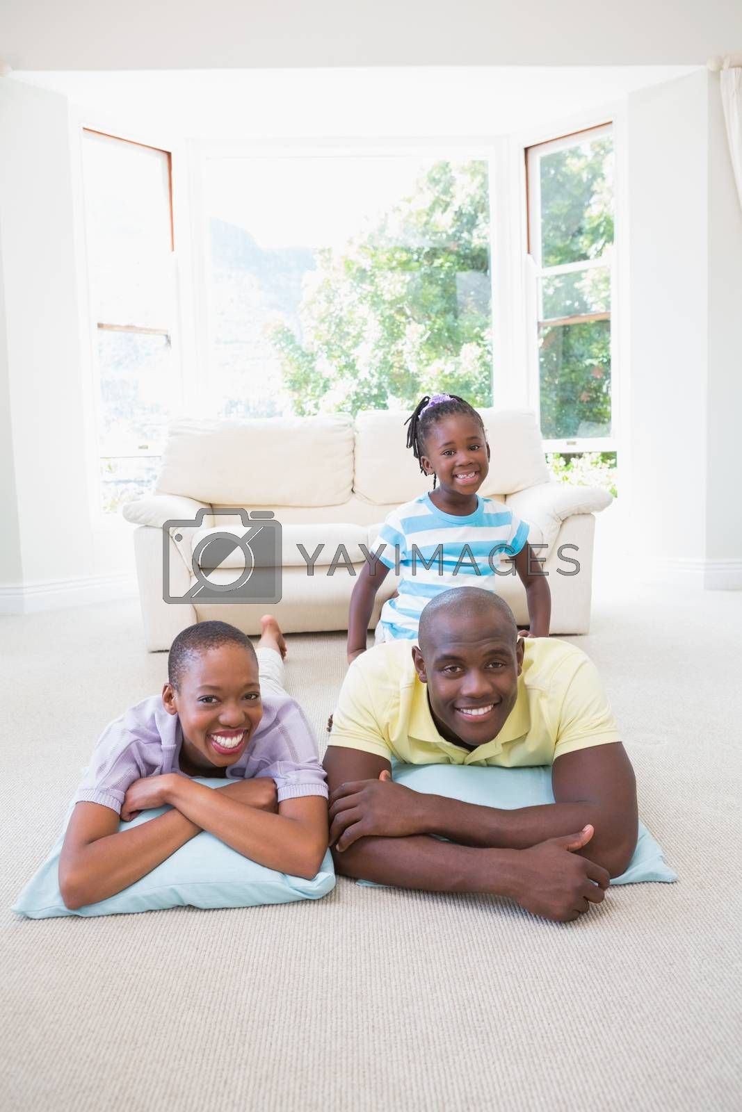 Royalty free image of Happy smiling couple lokking at camera with their daugther  by Wavebreakmedia