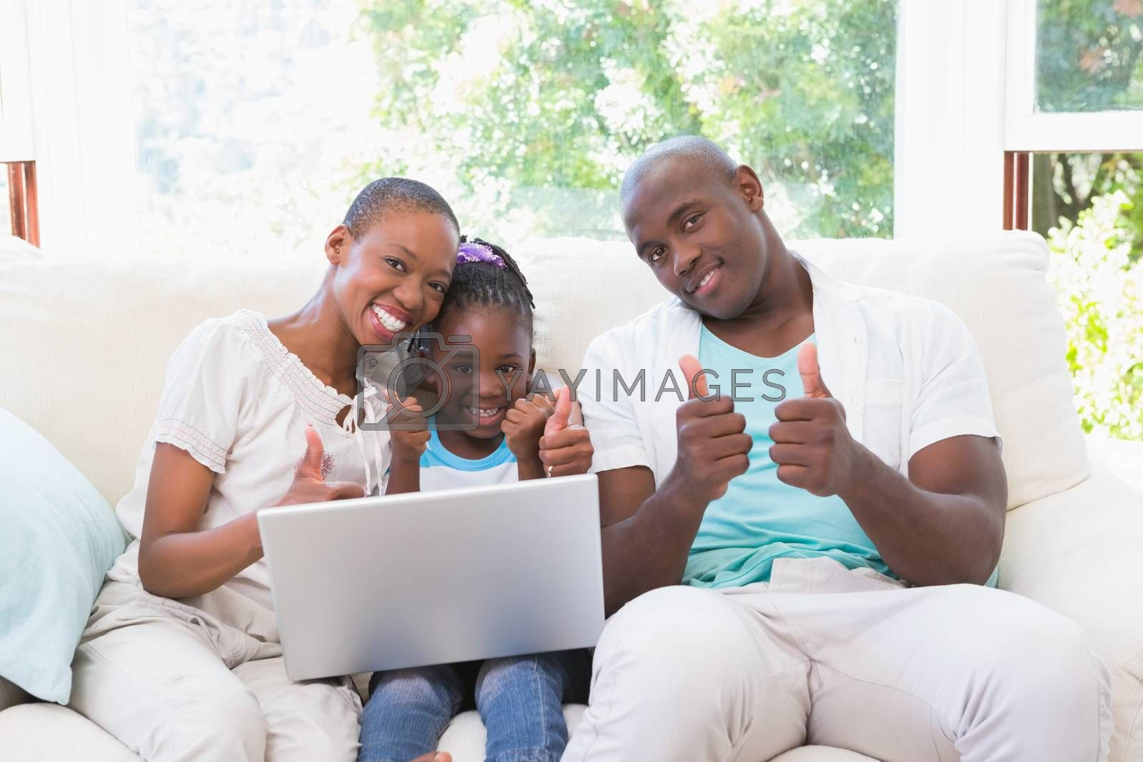 Royalty free image of Happy family on the couch with laptop  by Wavebreakmedia