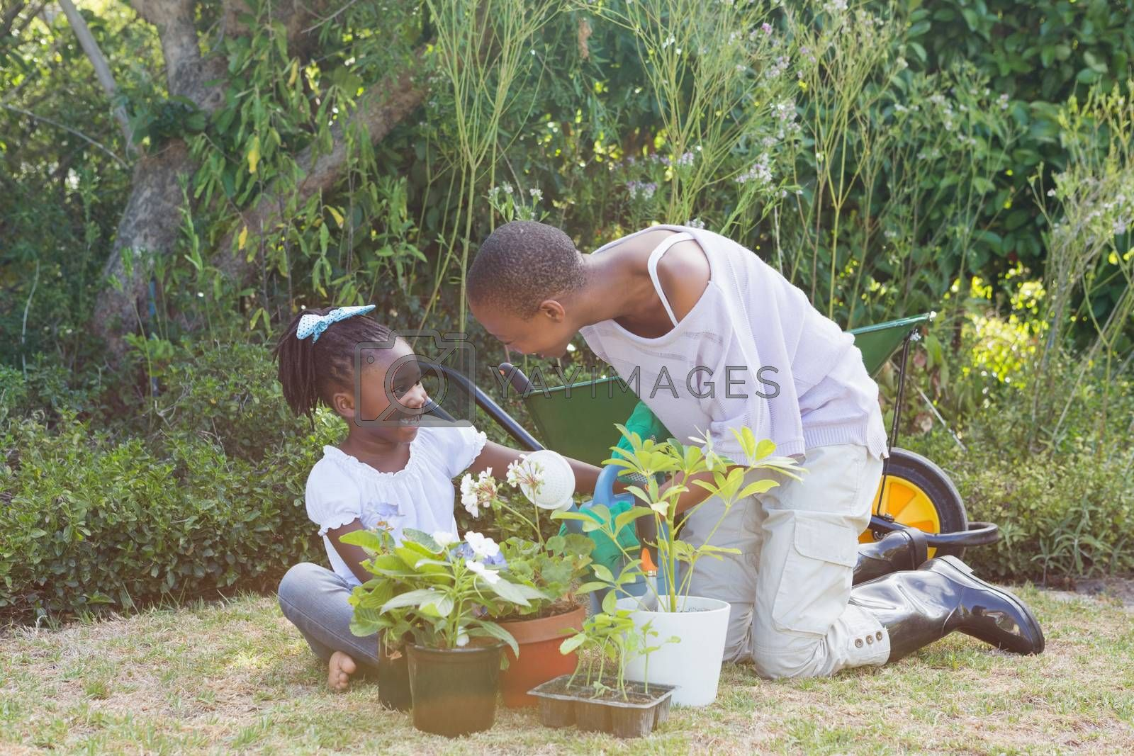 Royalty free image of Happy smiling mother gardening with her daughter by Wavebreakmedia