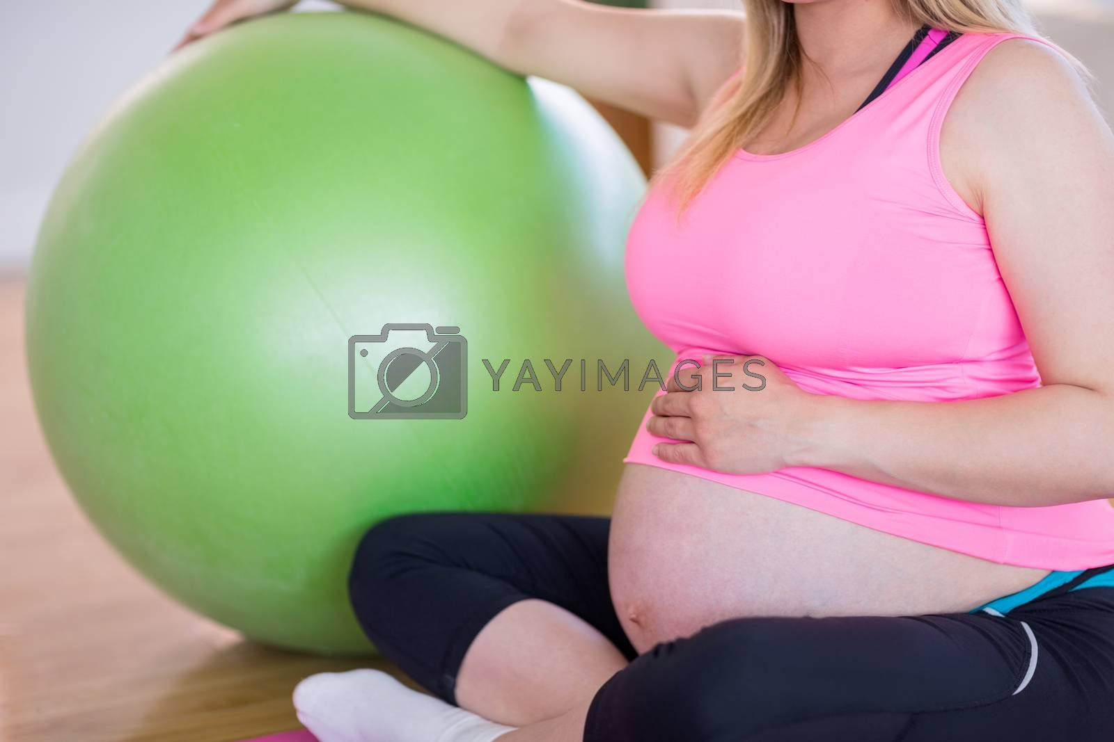 Royalty free image of Pregnant woman sitting with exercise ball  by Wavebreakmedia