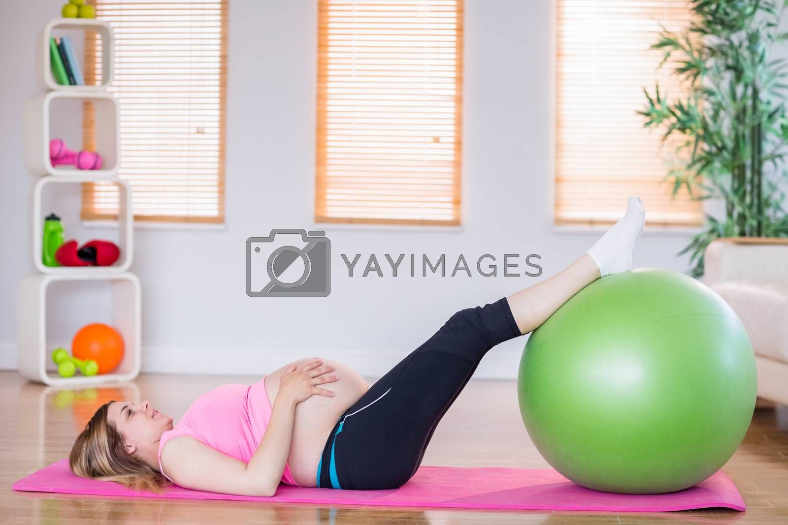 Royalty free image of Pregnant woman doing exercise with exercise ball  by Wavebreakmedia