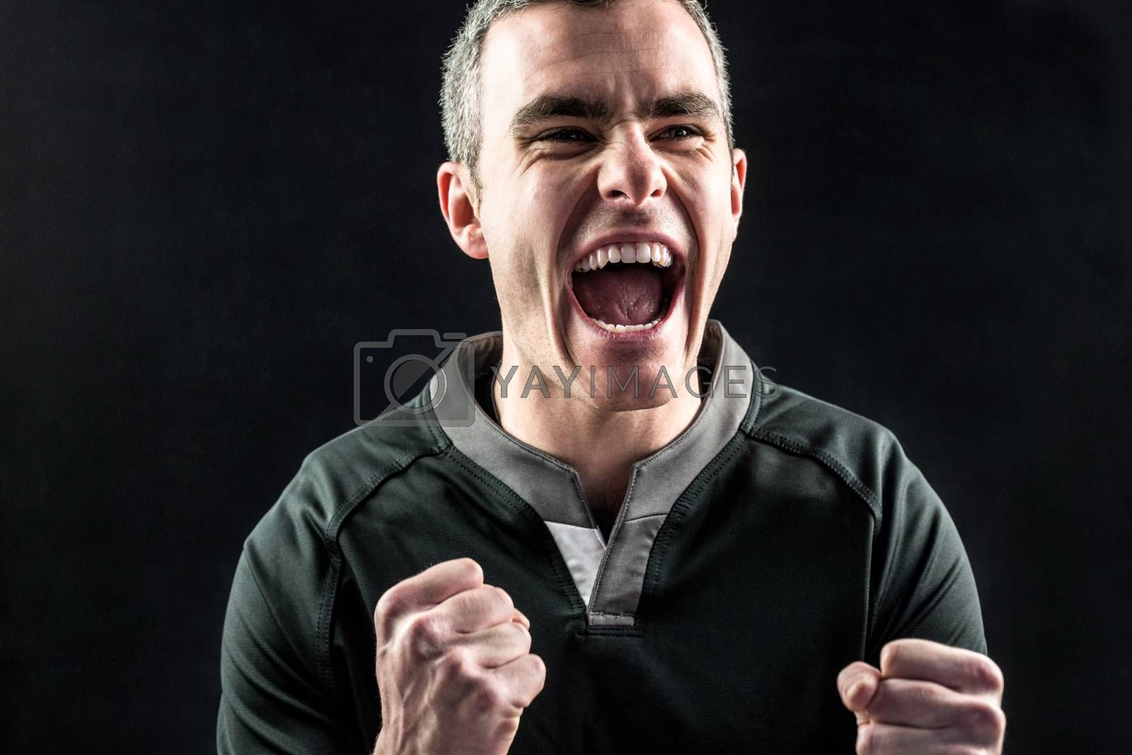 Royalty free image of Excited rugby player yelling out by Wavebreakmedia