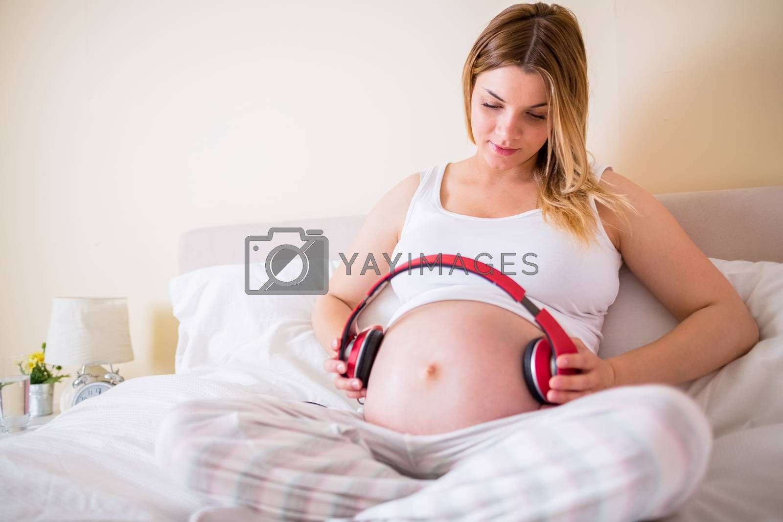 Royalty free image of Pregnant woman relaxing on bed  by Wavebreakmedia
