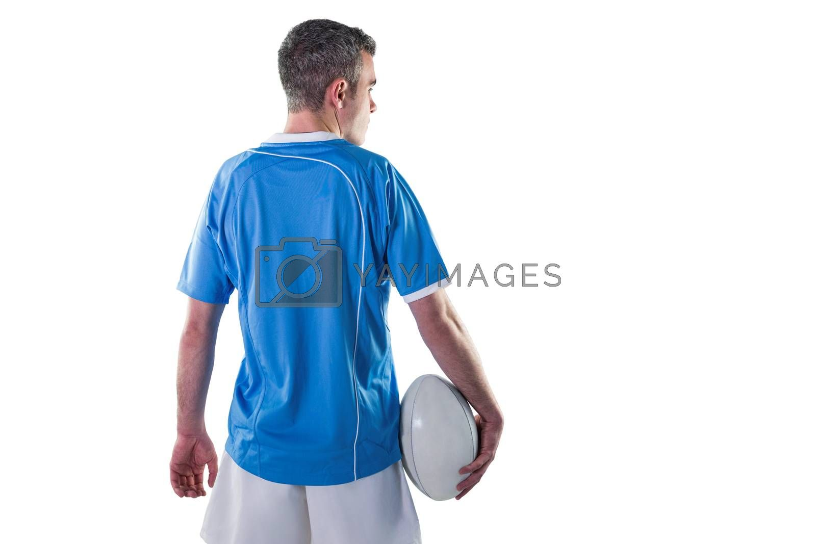 Royalty free image of Rugby player holding a rugby ball by Wavebreakmedia