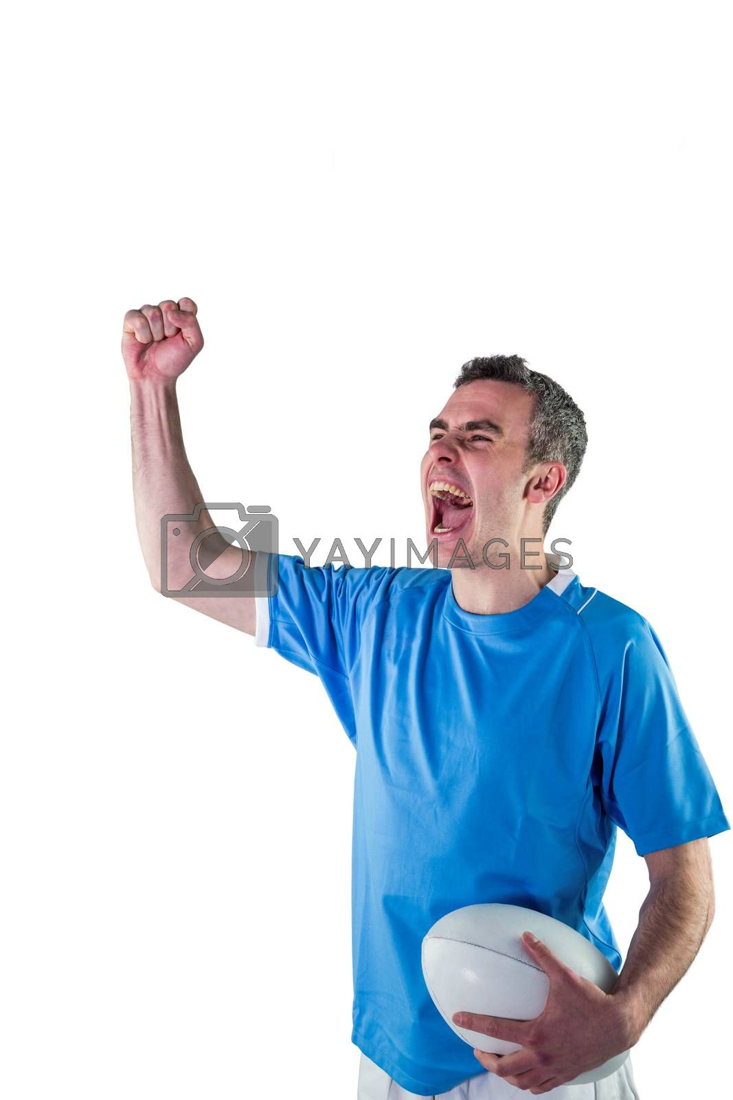 Royalty free image of A rugby player gesturing victory by Wavebreakmedia