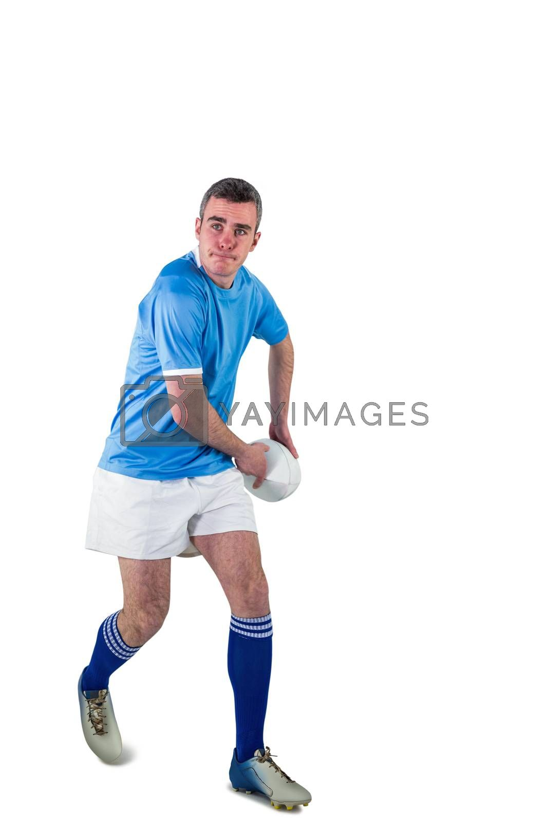 Royalty free image of Rugby player about to throw a rugby ball by Wavebreakmedia