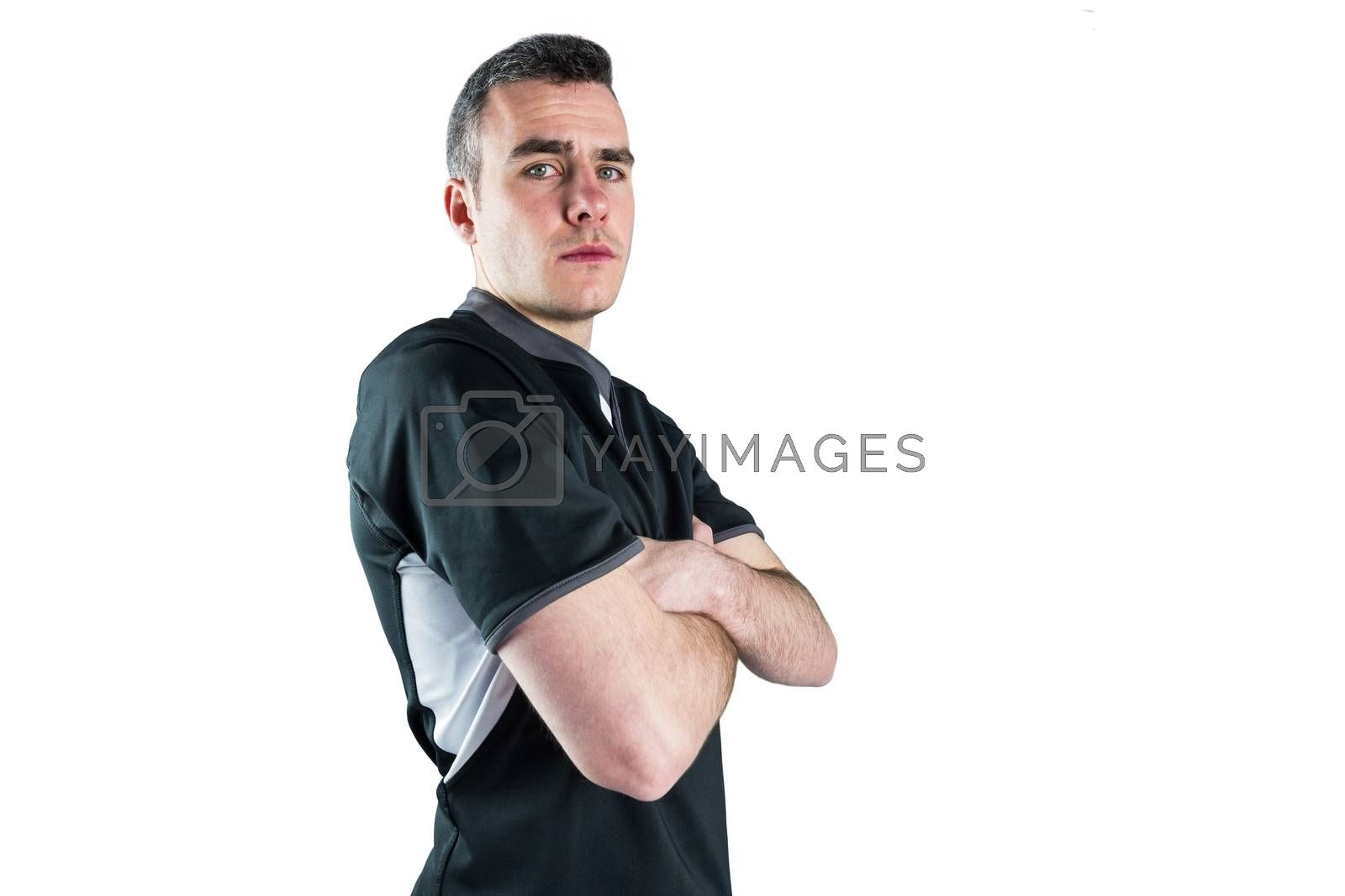 Royalty free image of Frowning rugby player with arms crossed by Wavebreakmedia