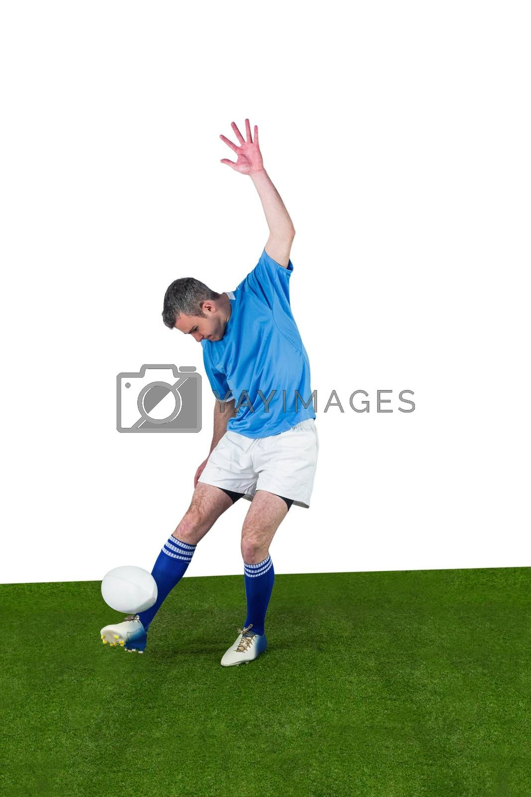 Royalty free image of Rugby player kicking a rugby ball by Wavebreakmedia