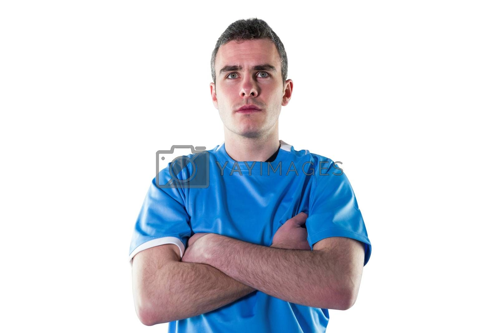 Royalty free image of Serious rugby player with arms crossed by Wavebreakmedia