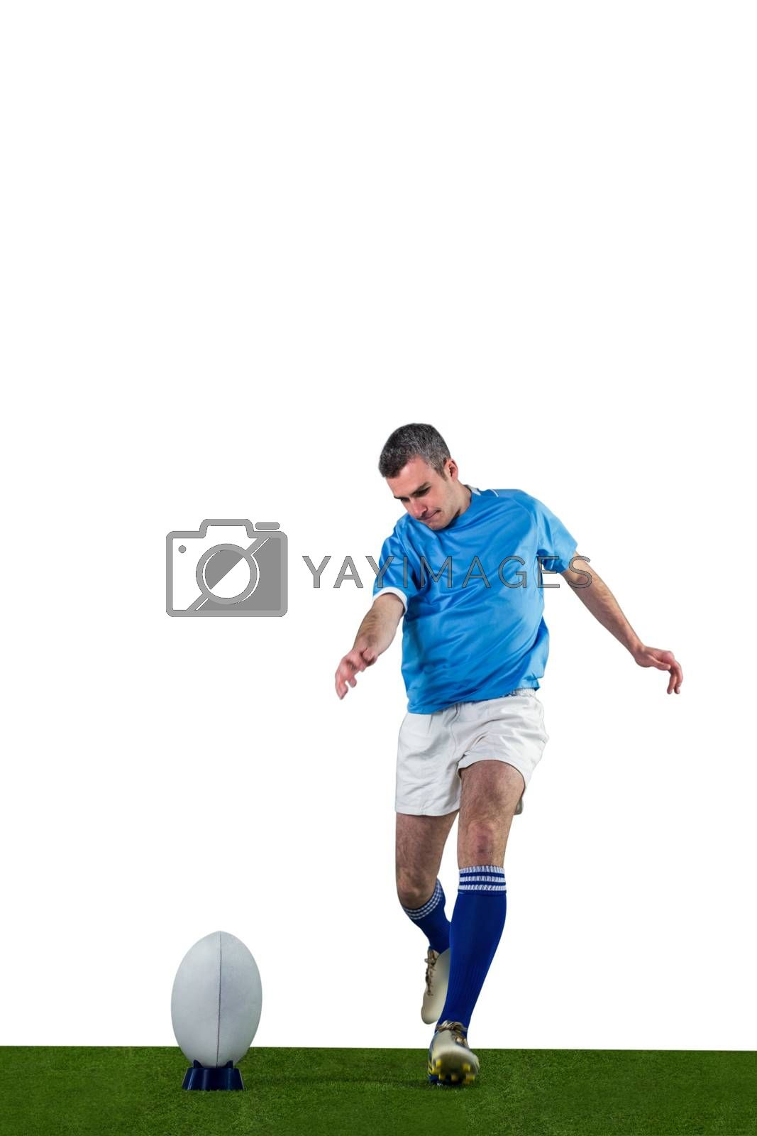 Royalty free image of Rugby player doing a drop kick by Wavebreakmedia