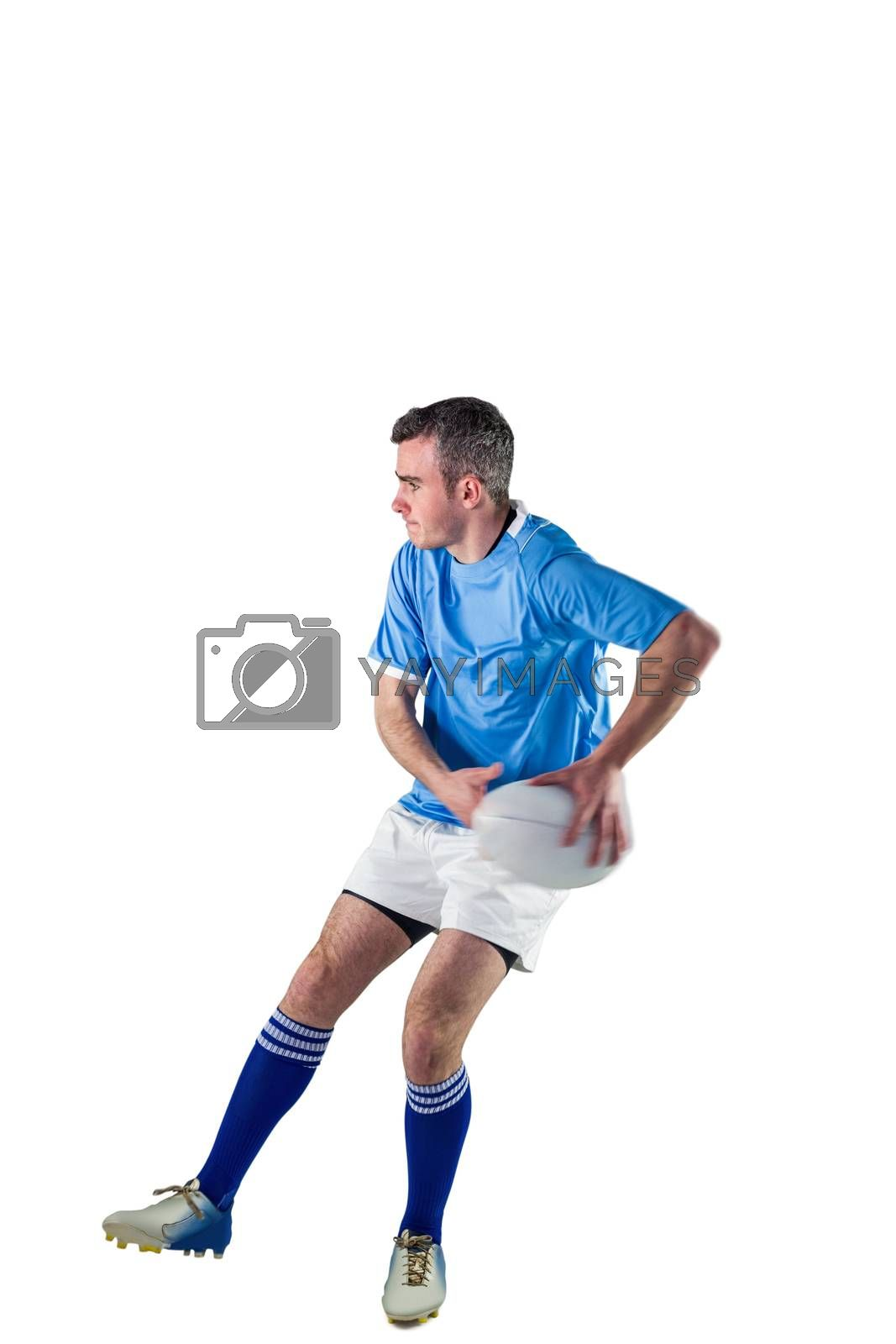 Royalty free image of Rugby player doing a side pass by Wavebreakmedia