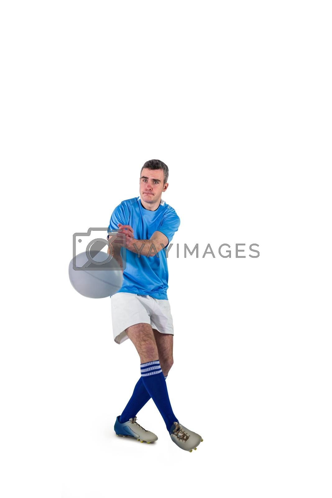Royalty free image of Rugby player throwing a rugby ball by Wavebreakmedia