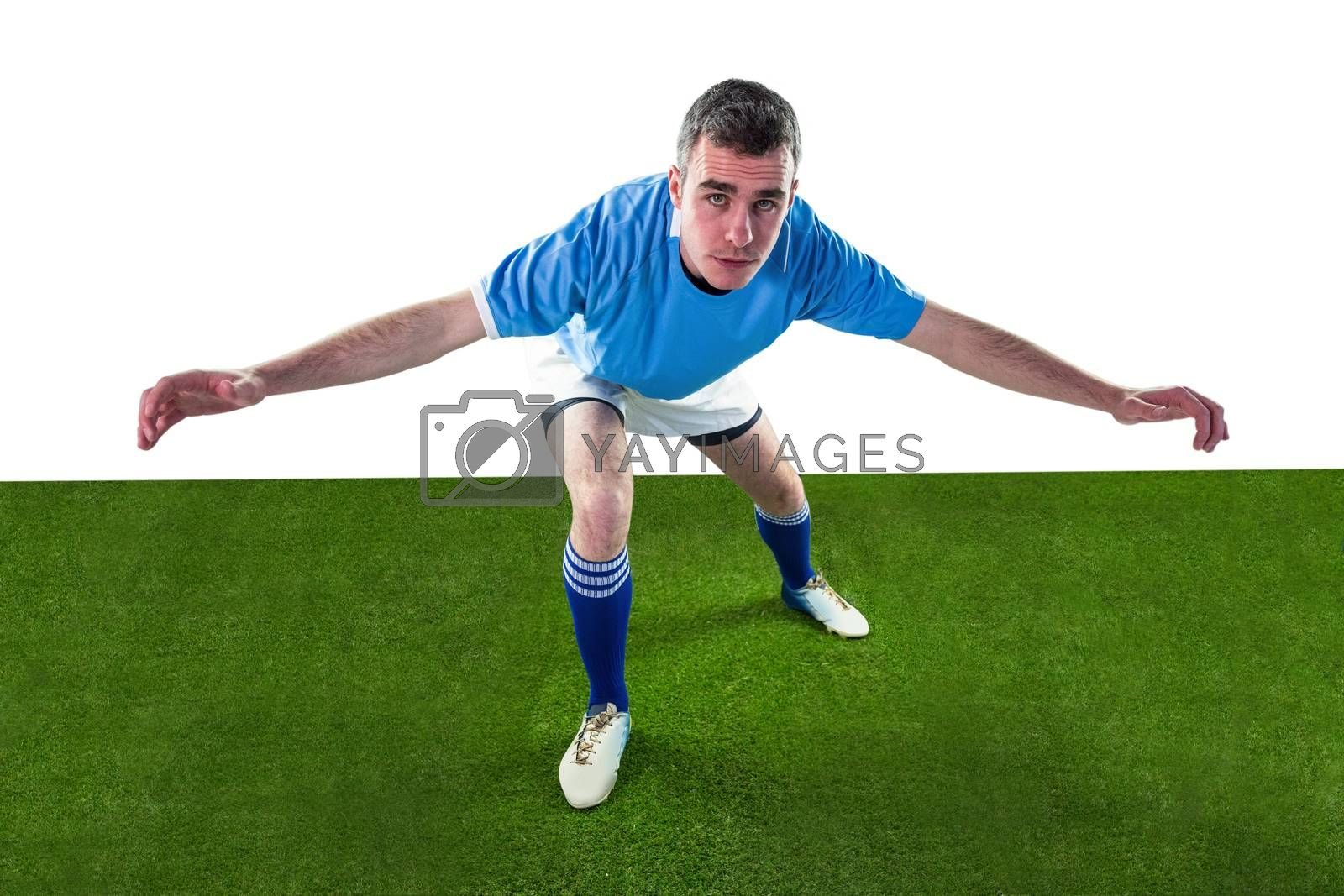 Royalty free image of Rugby player tackling the opponent by Wavebreakmedia