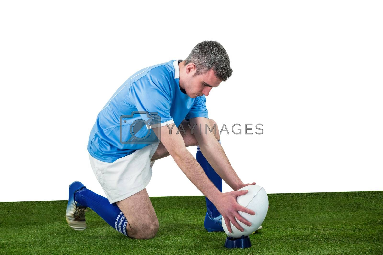 Royalty free image of Rugby player ready to make a drop kick by Wavebreakmedia