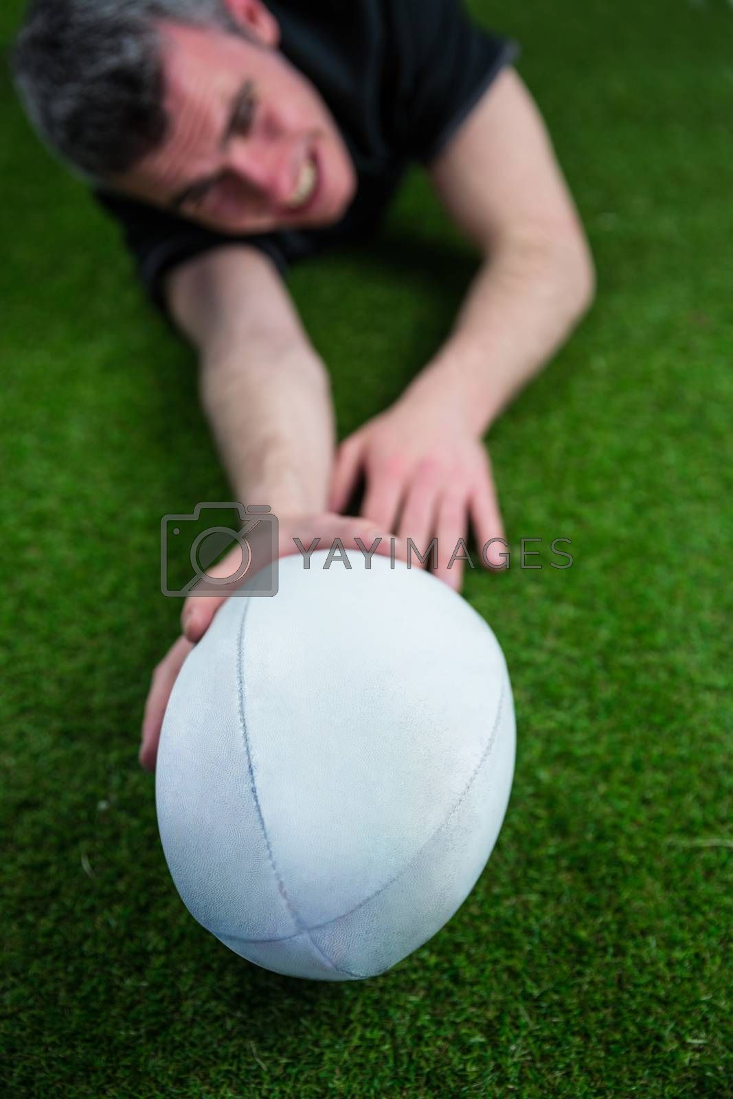Royalty free image of A rugby player scoring a try by Wavebreakmedia