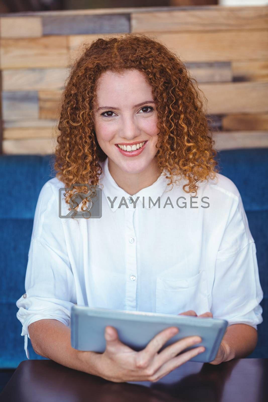 Royalty free image of pretty girl using a tablet by Wavebreakmedia