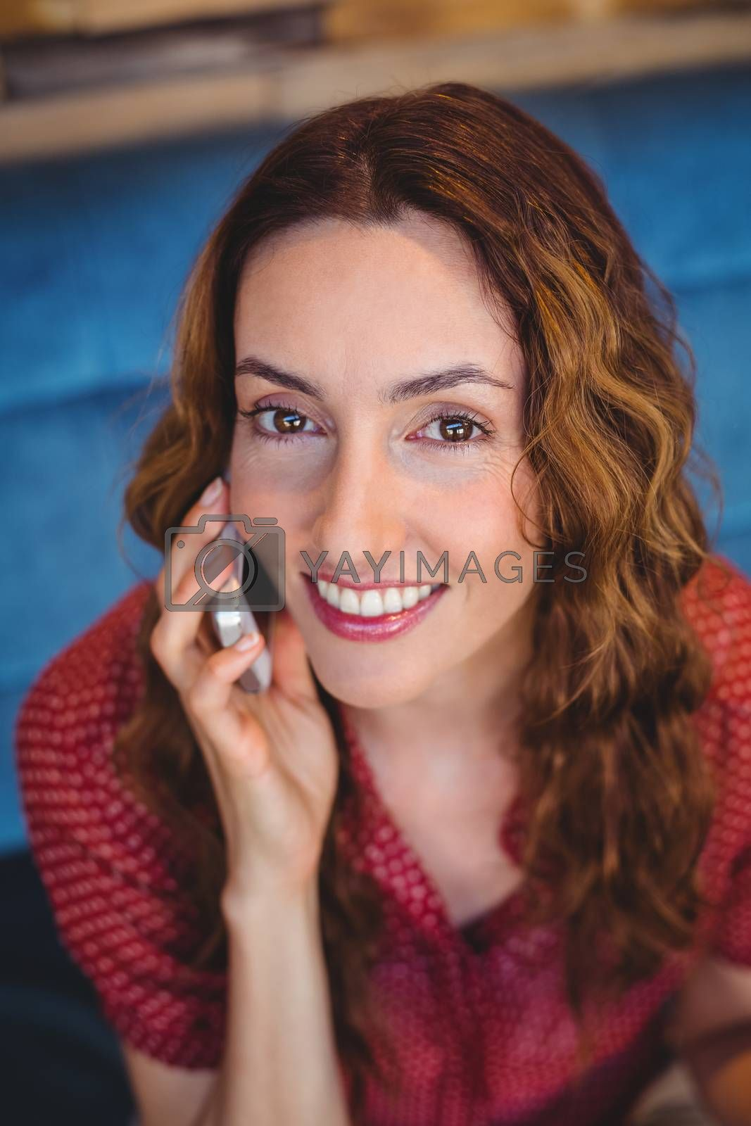 Royalty free image of Woman on the phone by Wavebreakmedia