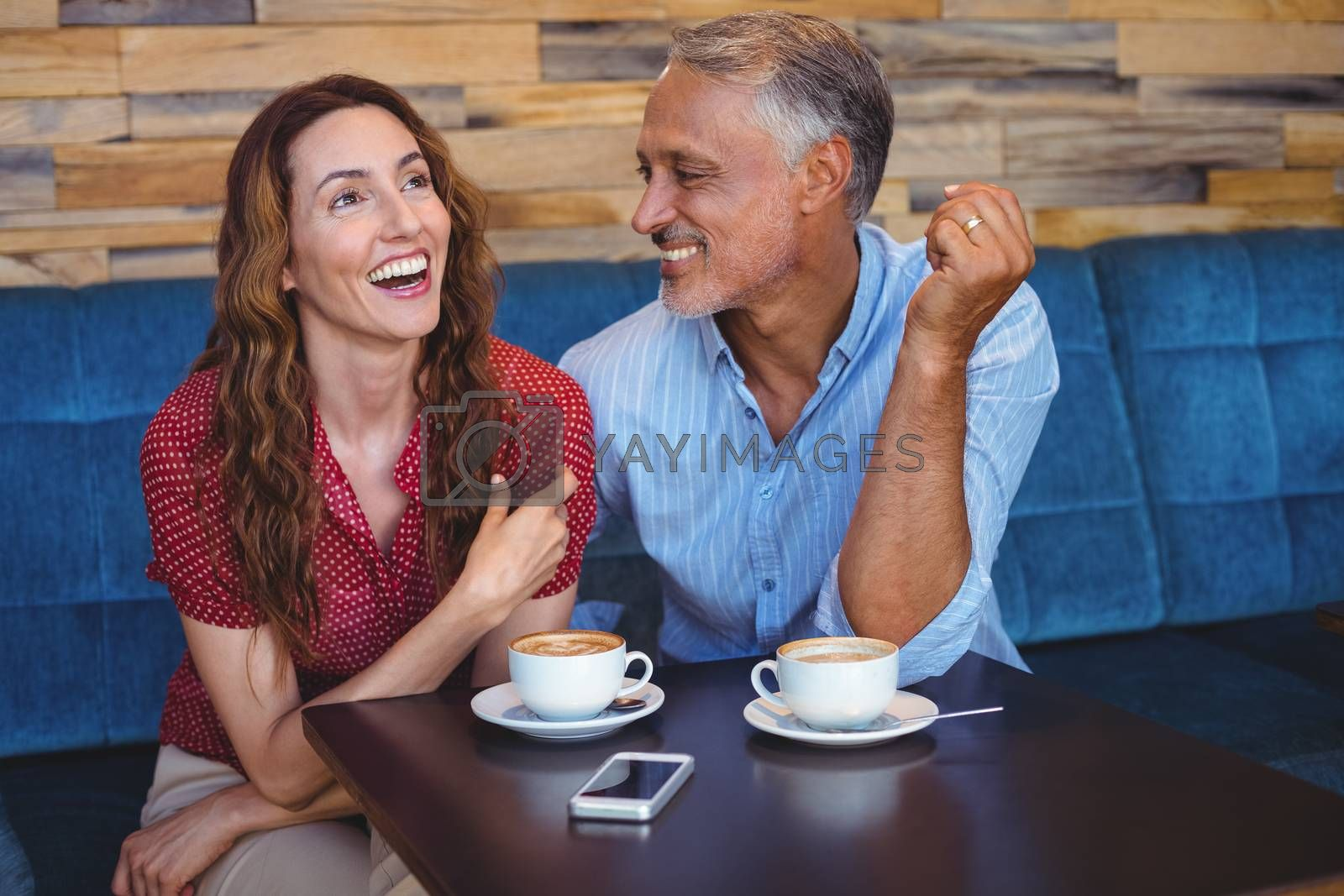 Royalty free image of Cute couple laughing  by Wavebreakmedia