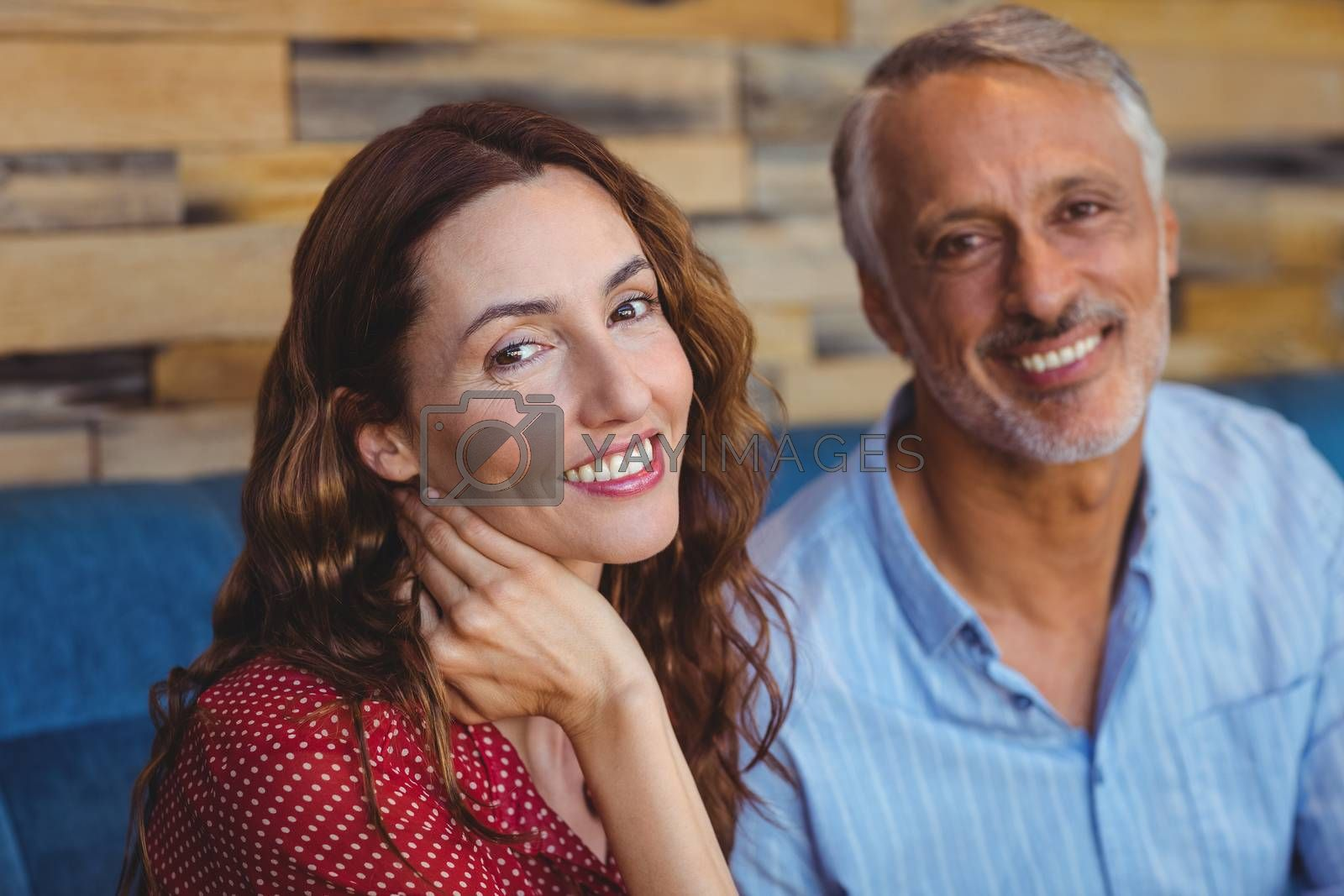 Royalty free image of Cute couple smiling at the camera by Wavebreakmedia