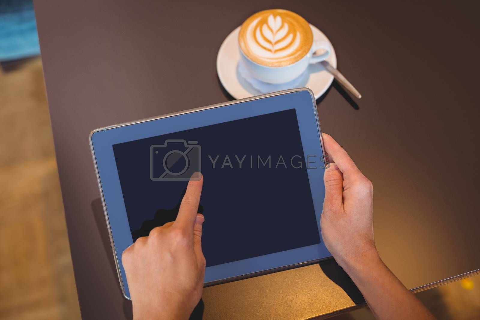 Royalty free image of Close-up of digital tablet and coffee on table by Wavebreakmedia