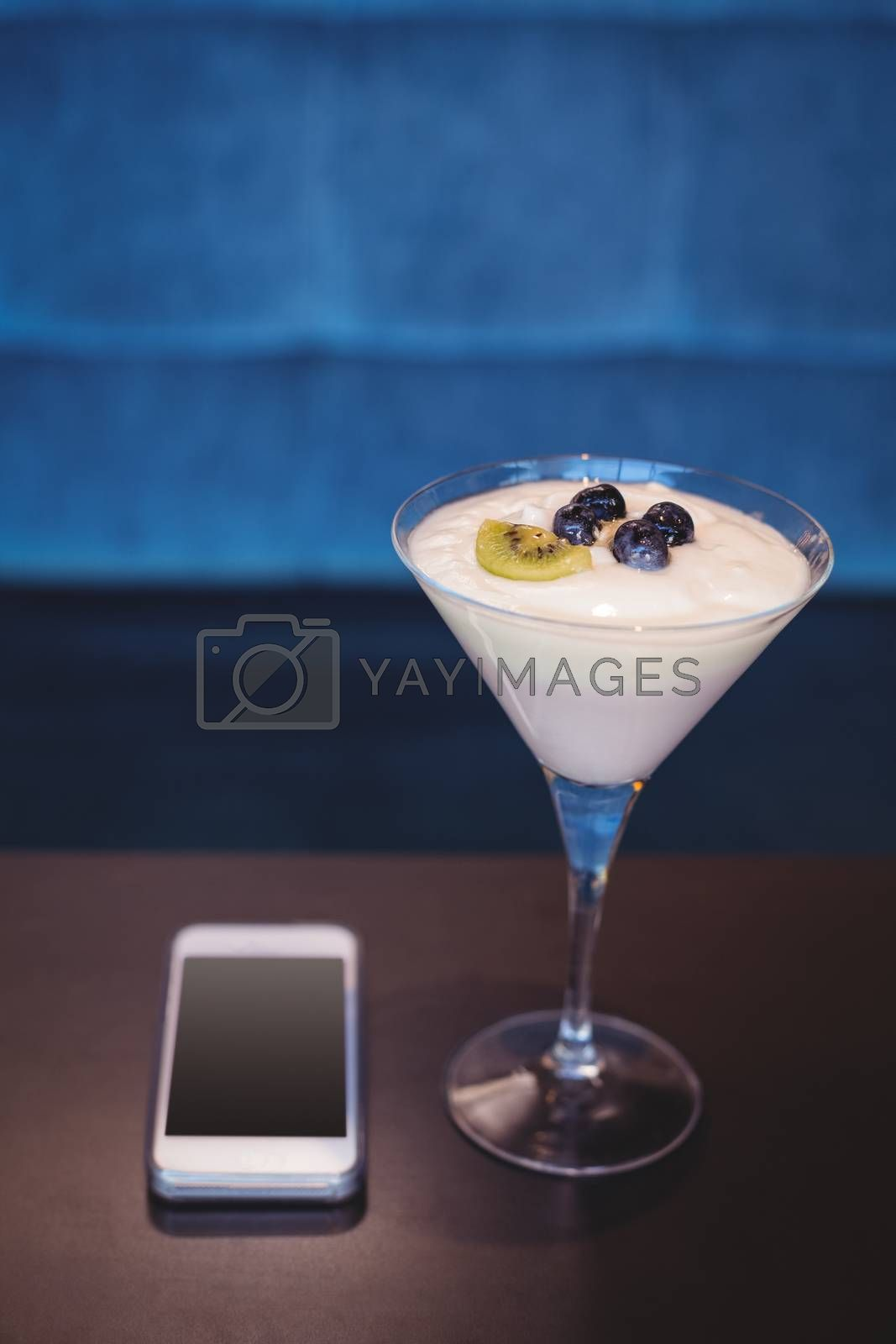 Royalty free image of close up view of a smartphone and a parfait  by Wavebreakmedia