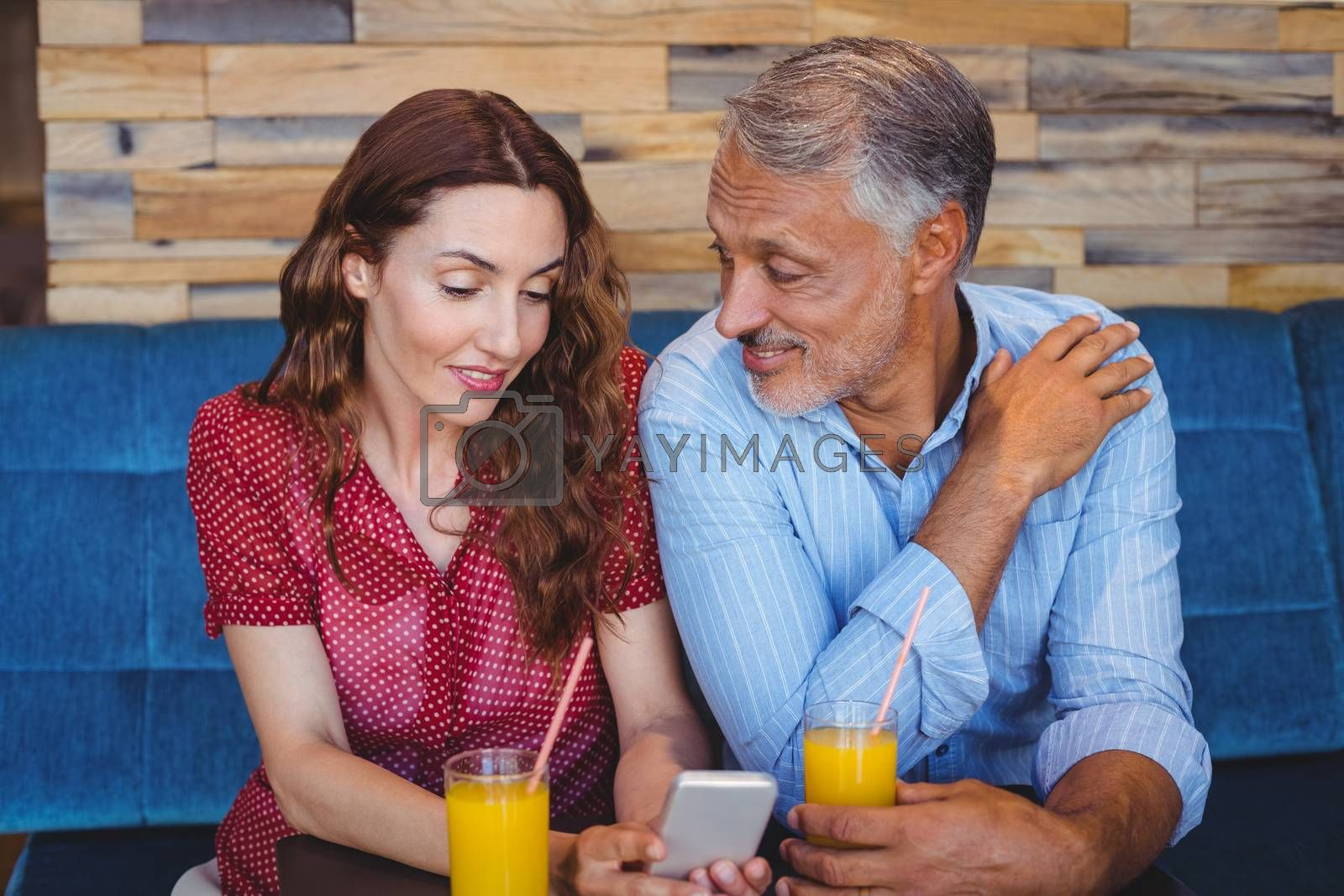 Royalty free image of Cute couple sitting in cafe  by Wavebreakmedia