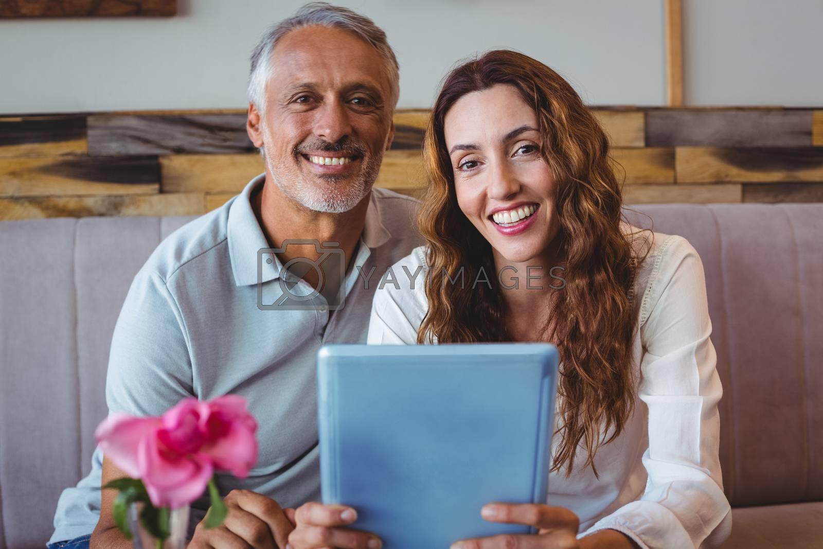 Royalty free image of Couple using digital tablet  by Wavebreakmedia