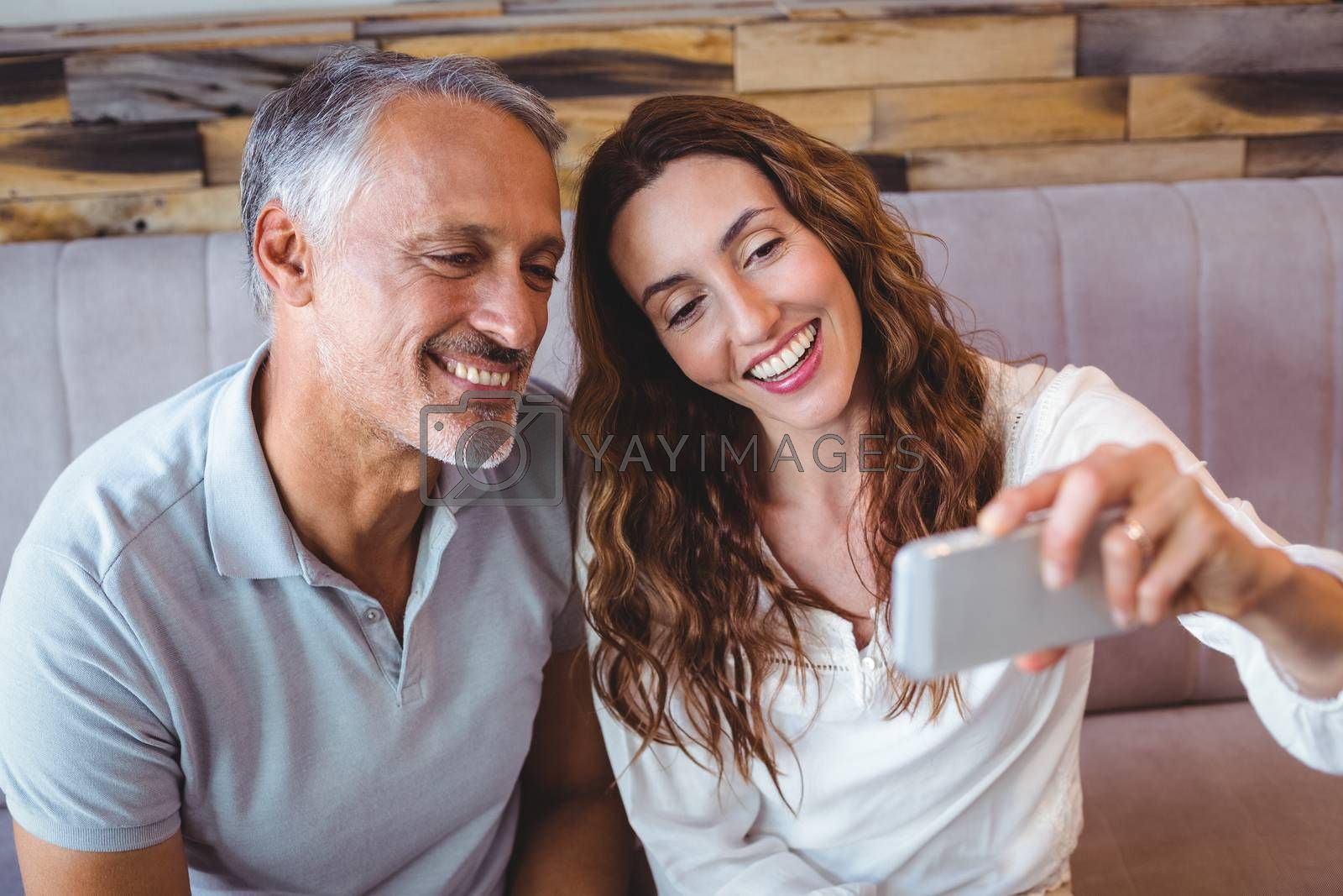 Royalty free image of Couple taking a selfie by Wavebreakmedia