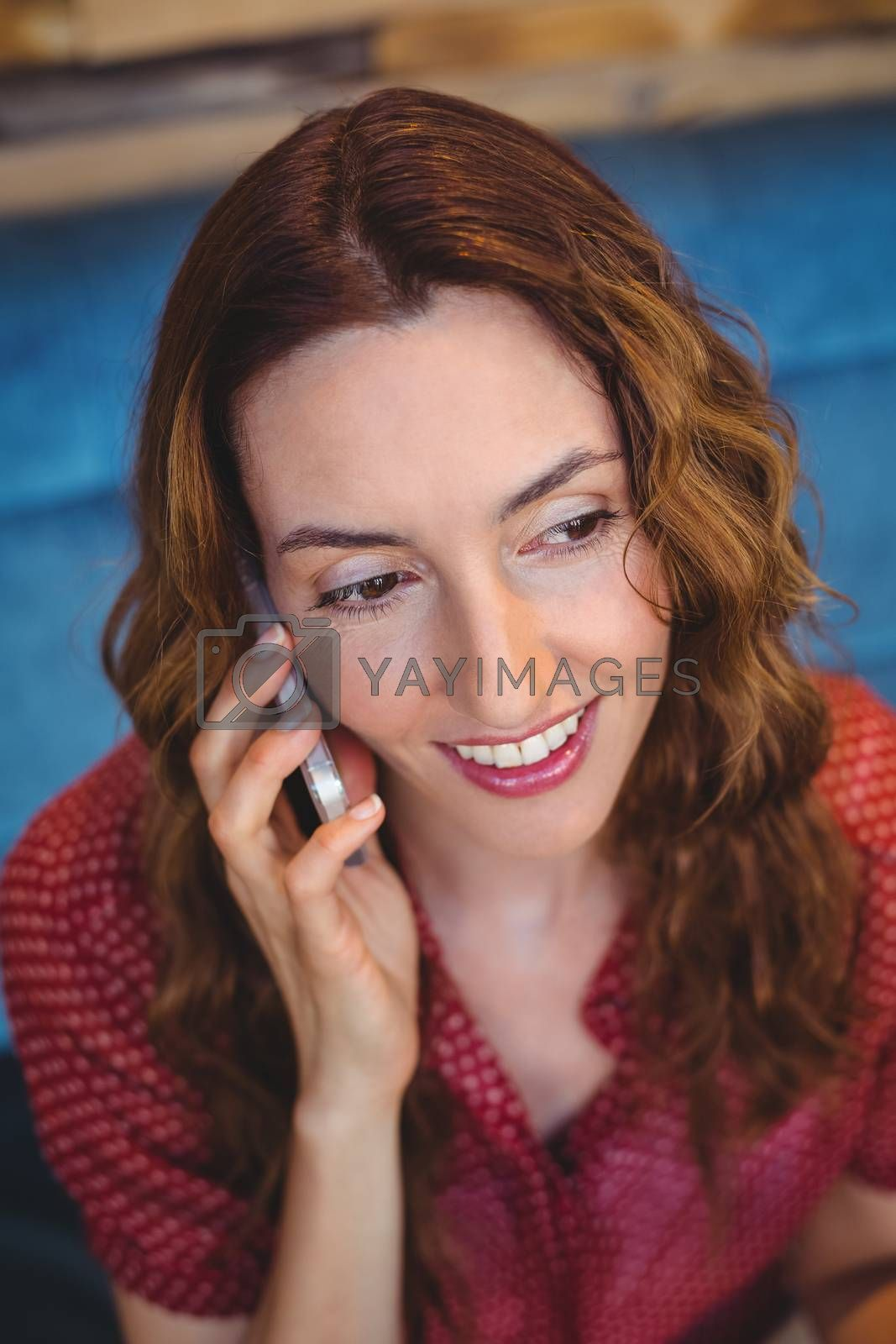 Royalty free image of Woman using her mobile phone by Wavebreakmedia