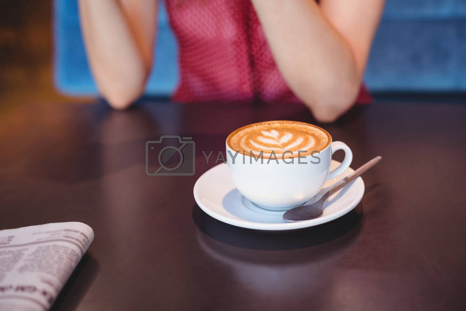 Royalty free image of a cup of coffee on the table  by Wavebreakmedia