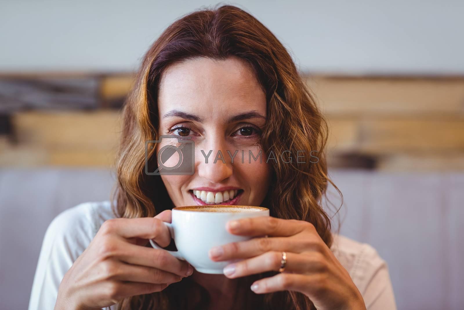 Royalty free image of Pretty brunette having coffee  by Wavebreakmedia