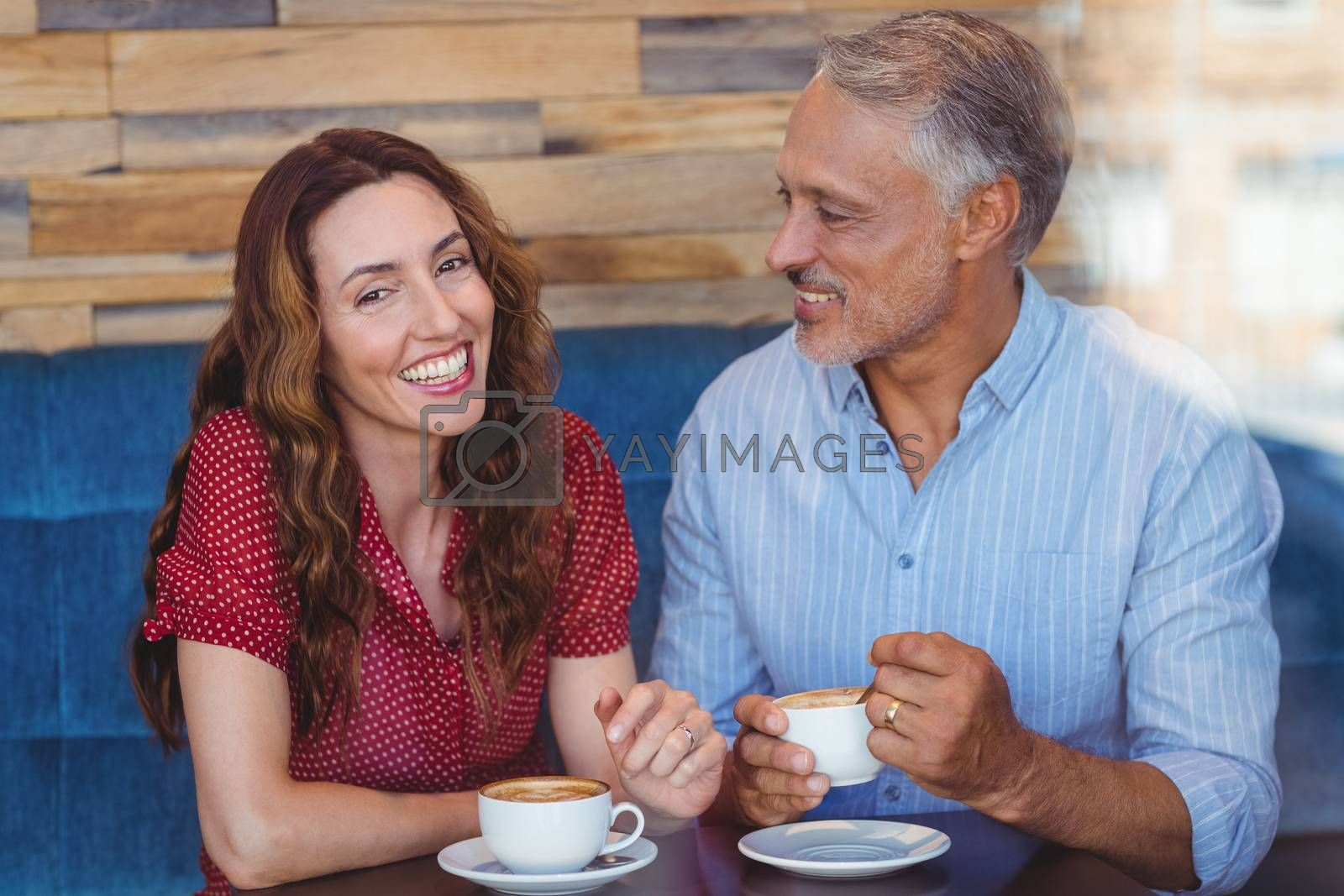 Royalty free image of Cute couple drinking coffee  by Wavebreakmedia