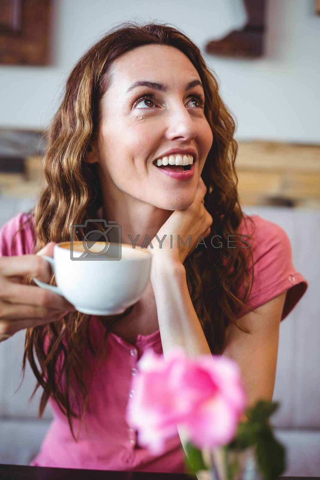 Royalty free image of Woman enjoying her cup of coffee by Wavebreakmedia