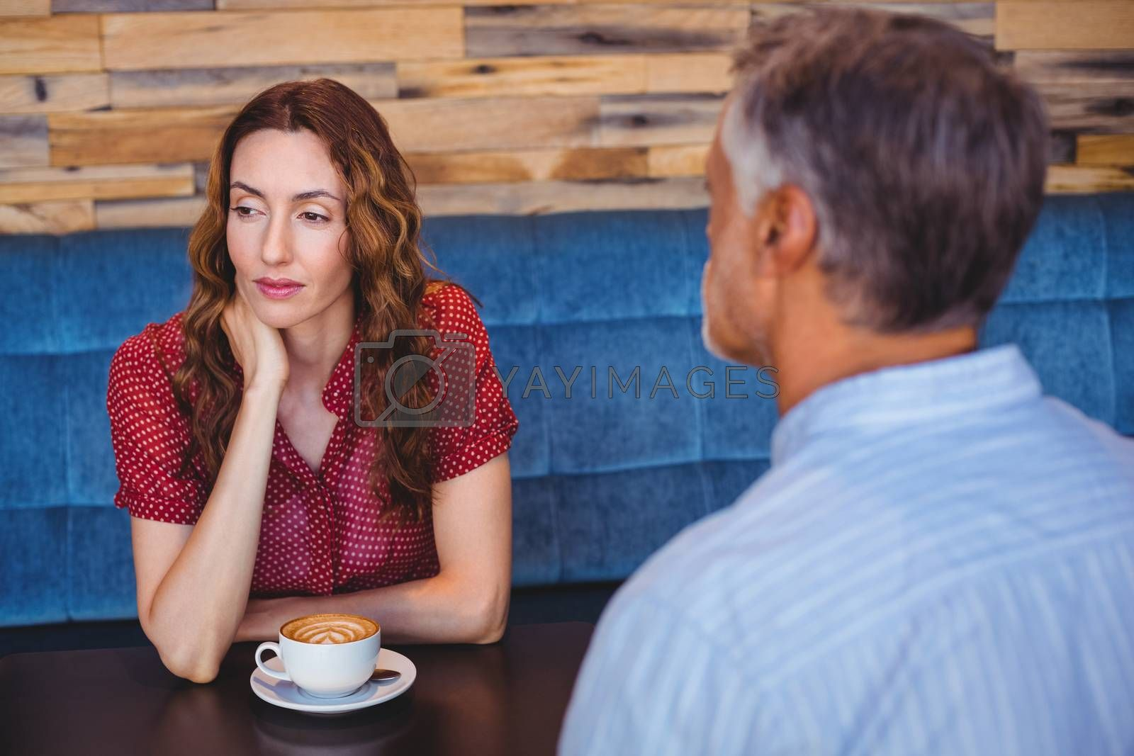 Royalty free image of bored couple having coffee together  by Wavebreakmedia