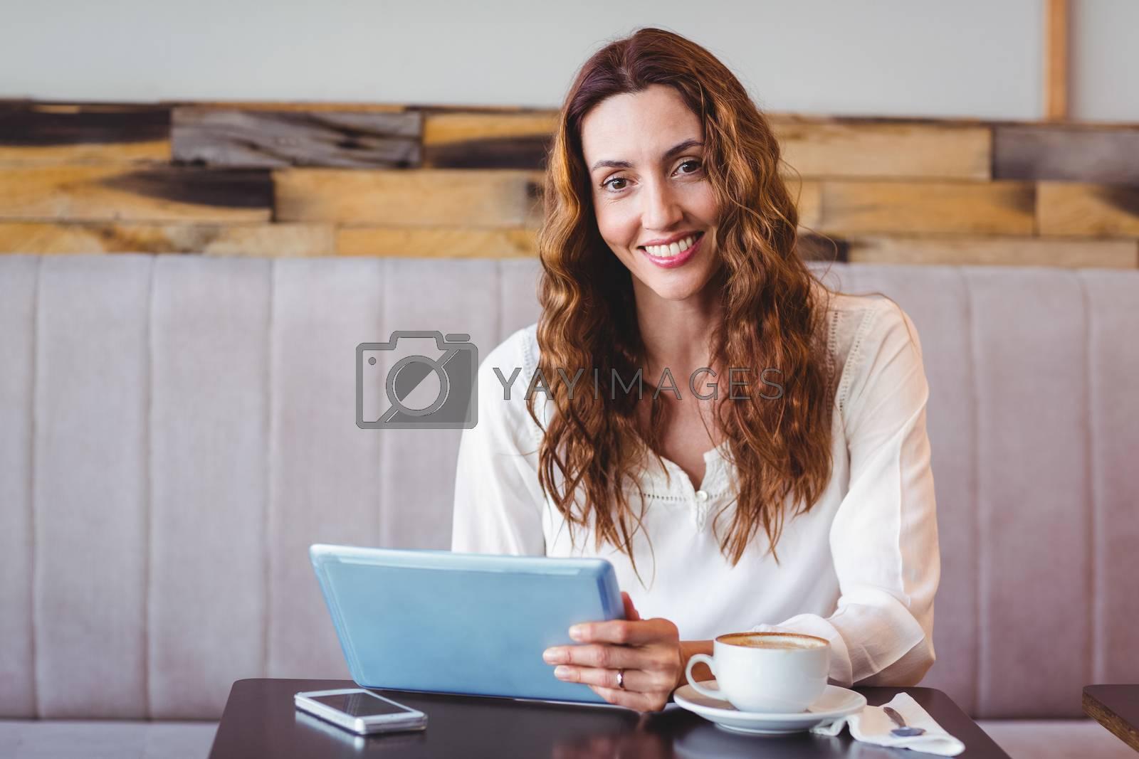Royalty free image of Woman using digital tablet  by Wavebreakmedia