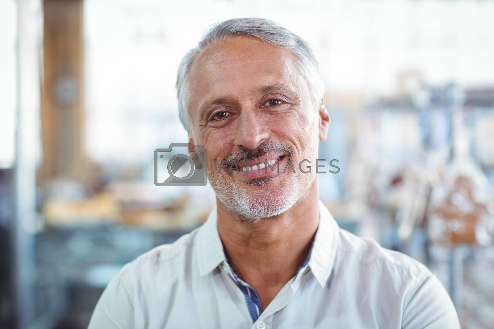 Royalty free image of smiling customer looking at the camera by Wavebreakmedia