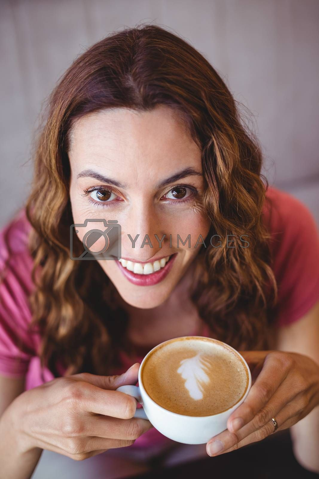Royalty free image of Young woman having a coffee by Wavebreakmedia