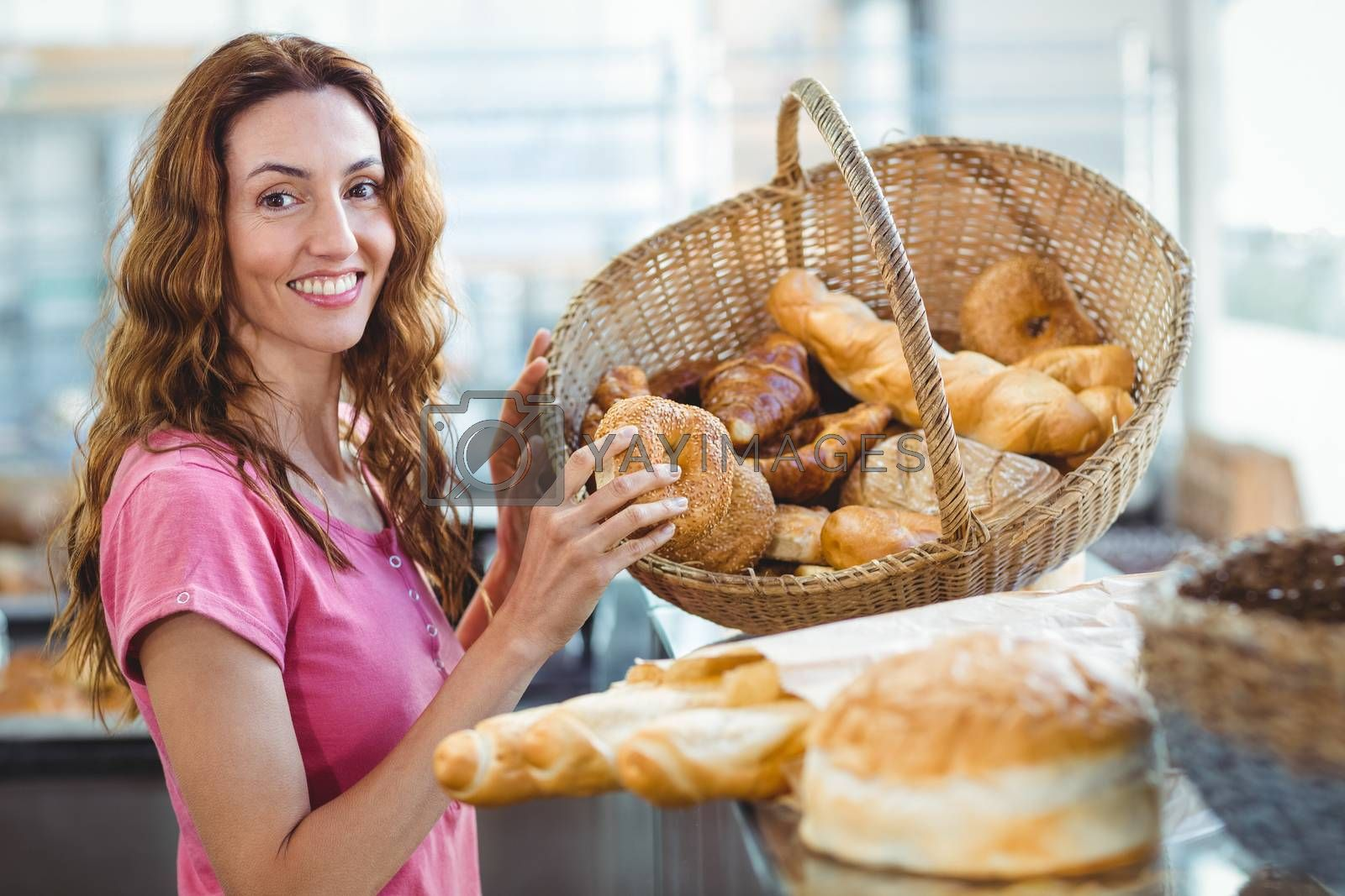 Royalty free image of Pretty brunette picking out croissant  by Wavebreakmedia