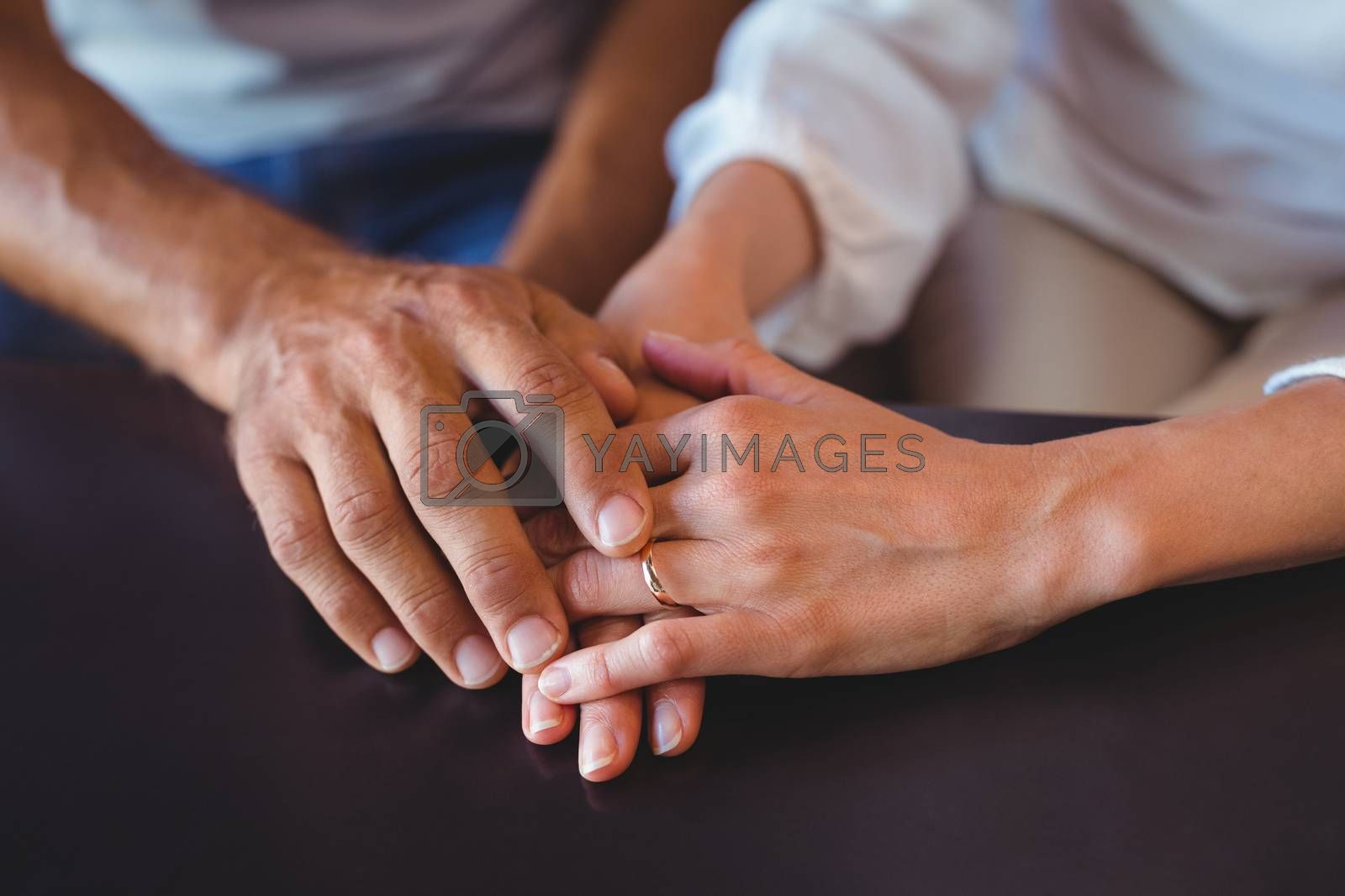 Royalty free image of Happy couple holding hands by Wavebreakmedia