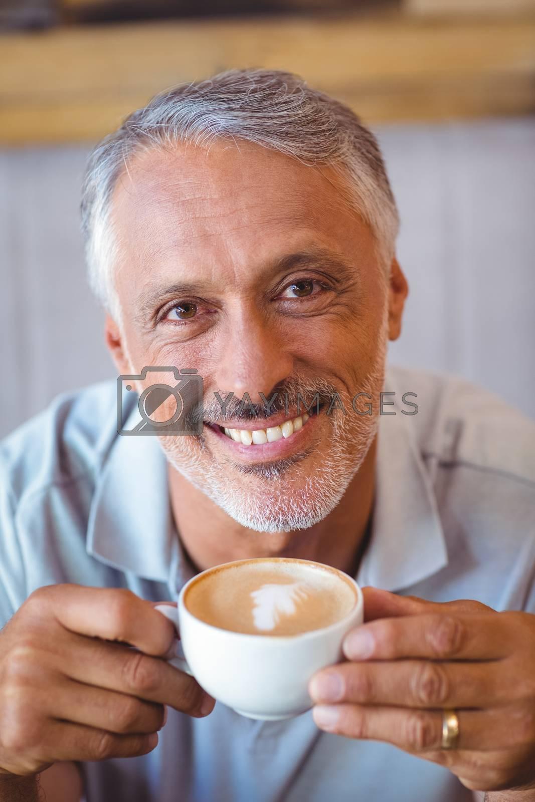 Royalty free image of Man sitting in cafe having coffee by Wavebreakmedia
