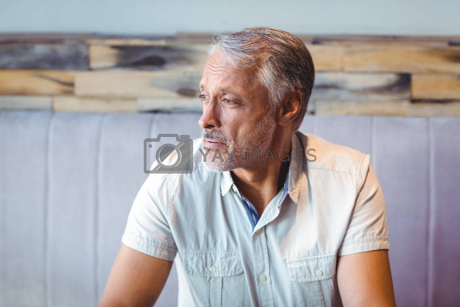 Royalty free image of Thoughtful man looking away in coffee shop by Wavebreakmedia