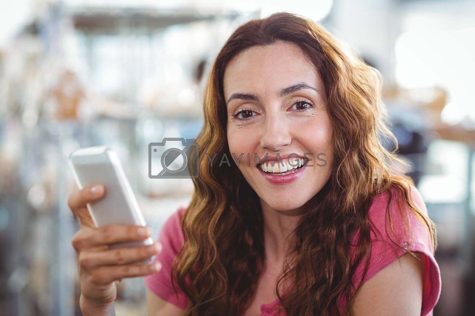 Royalty free image of Woman using the phone by Wavebreakmedia