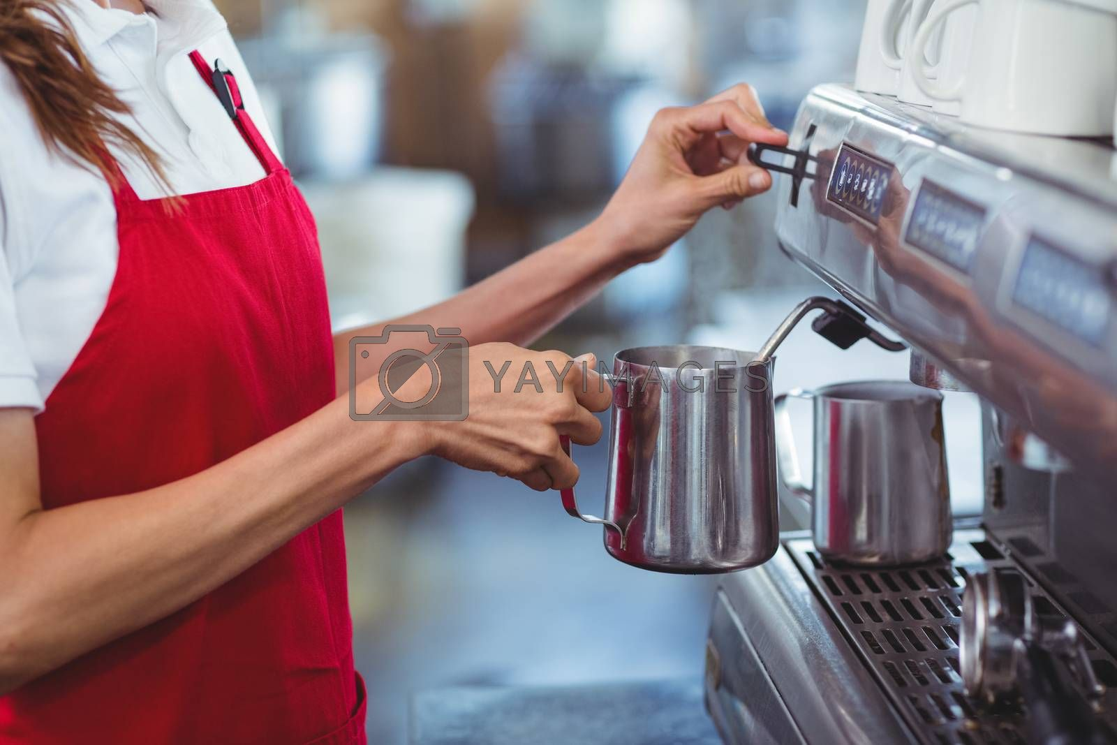 Royalty free image of A barista using the coffee machine by Wavebreakmedia